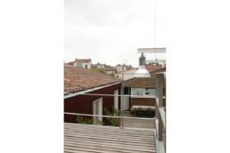 touton architectes - maison - bordeaux - balcon suspendu - bois et métal - terrasse coeur d'ilôt